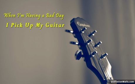 Motivational quote desktop: When I'm having a bad day, I pick up my guitar.